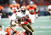 Jerry Rice of the San Francisco 49ers runs with the ball against the Denver Broncos during Super Bowl XXIV on January 28 1990 at the Super Dome in...