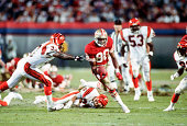 Jerry Rice of the San Francisco 49ers runs with the ball while being pursued by David Fulcher of the Cincinnati Bengals during Super Bowl XXIII on...