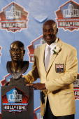Jerry Rice poses with his bust during the 2010 Pro Football Hall of Fame Enshrinement Ceremony at the Pro Football Hall of Fame Field at Fawcett...