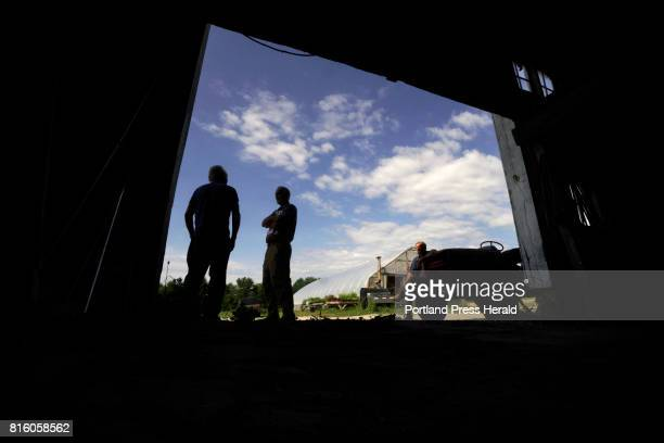 Jerry Rivard left and Lee Burnett talk outside a barn at Rivard's farm In Springvale on Thursday July 6 2017 Rivard's farm is one of ten farms in...