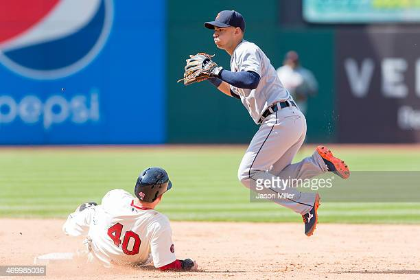 Jerry Sands of the Cleveland Indians is out at second as shortstop Jose Iglesias of the Detroit Tigers throws to first at Progressive Field on April...