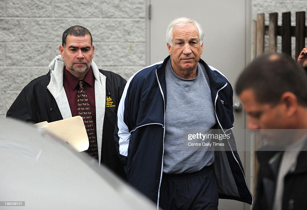 <a gi-track='captionPersonalityLinkClicked' href=/galleries/search?phrase=Jerry+Sandusky&family=editorial&specificpeople=8608969 ng-click='$event.stopPropagation()'>Jerry Sandusky</a>, former Penn State assistant football coach, is escorted to a police car after being charged with additional counts of sexual abuse involving two more boys, Wednesday, December 7, 2011, in Bellefonte, Pennsylvania.