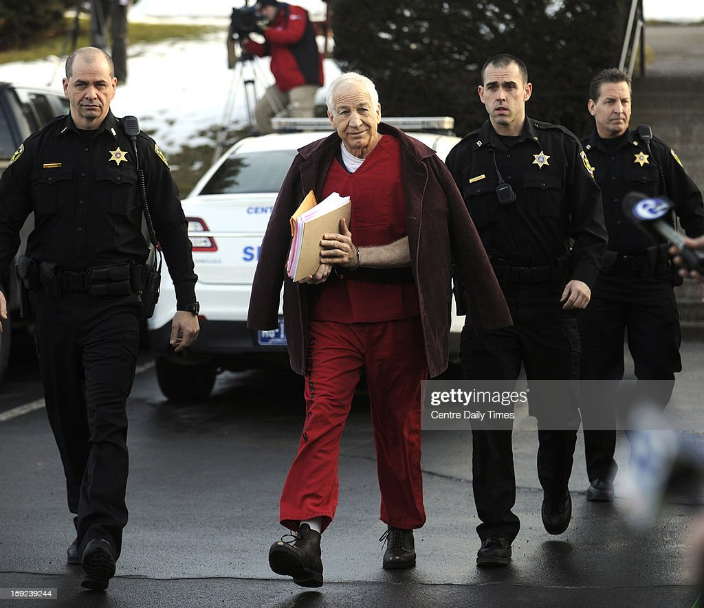 <a gi-track='captionPersonalityLinkClicked' href=/galleries/search?phrase=Jerry+Sandusky&family=editorial&specificpeople=8608969 ng-click='$event.stopPropagation()'>Jerry Sandusky</a> is escorted to the Centre County Courthouse in Bellefonte, Pennsylvania, for a hearing on Thursday, January 10, 2013.