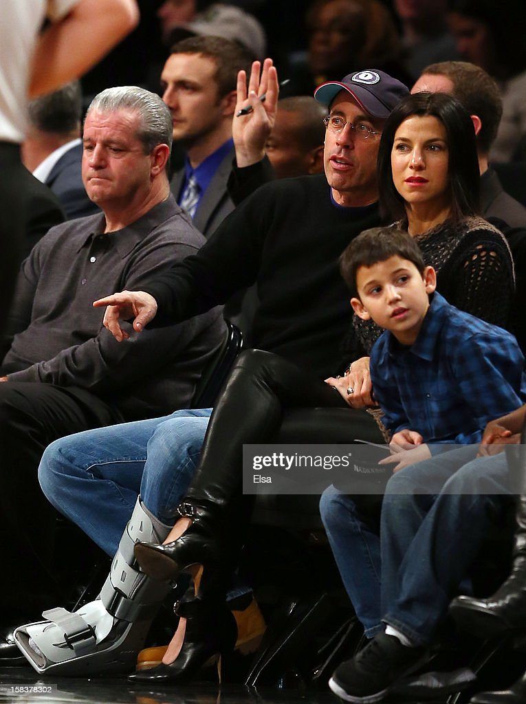 Jerry Seinfeld attends the game between the Brooklyn Nets and the Detroit Pistons on December 14, 2012 at the Barclays Center in the Brooklyn borough of New York City.