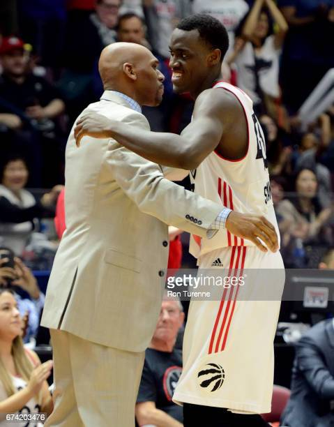 Jerry Stackhouse head coach of the Raptors 905 hugs his player Pascal Siakam as he comes out of Game Three of the DLeague Finals against the Rio...