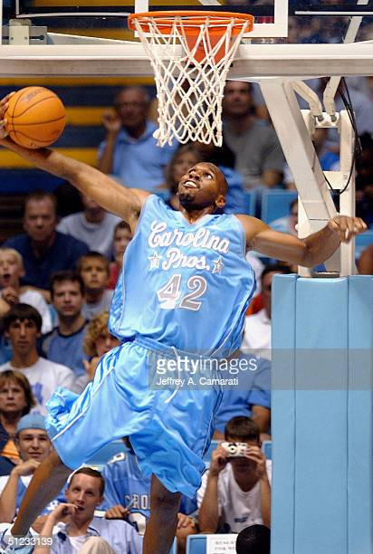 Jerry Stackhouse of Carolina Pros goes in for a dunk during the World's Greatest Alumni Game at the Dean Smith Center on the campus of the University...