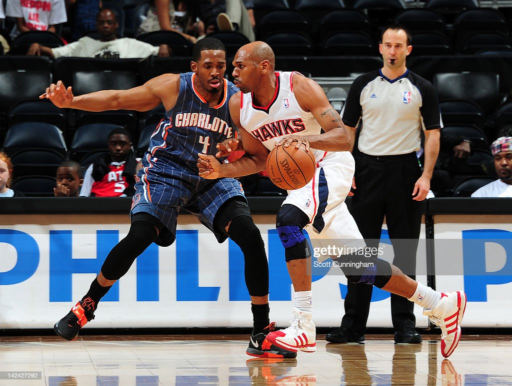 <a gi-track='captionPersonalityLinkClicked' href=/galleries/search?phrase=Jerry+Stackhouse&family=editorial&specificpeople=201683 ng-click='$event.stopPropagation()'>Jerry Stackhouse</a> #42 of the Atlanta Hawks drives against Derrick Brown #4 of the Charlotte Bobcats on April 4, 2012 at Philips Arena in Atlanta, Georgia.