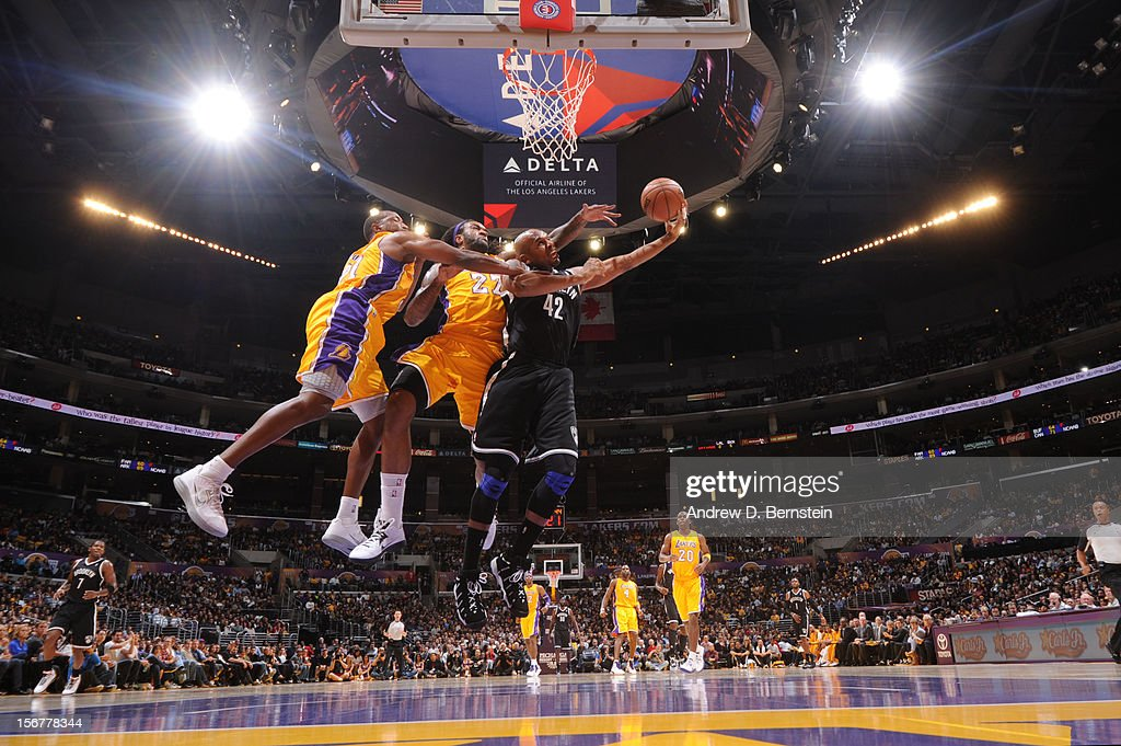 Jerry Stackhouse #42 of the Brooklyn Nets draws contact on a shot attempt against Jordan Hill #27 and Chris Duhon #21 of the Los Angeles Lakers at Staples Center on November 20, 2012 in Los Angeles, California.
