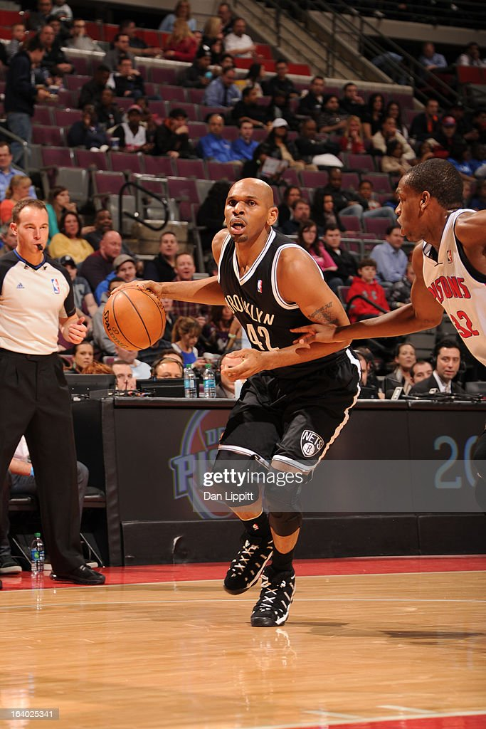 Jerry Stackhouse #42 of the Brooklyn Nets drives against Khris Middleton #32 of the Detroit Pistons on March 18, 2013 at The Palace of Auburn Hills in Auburn Hills, Michigan.