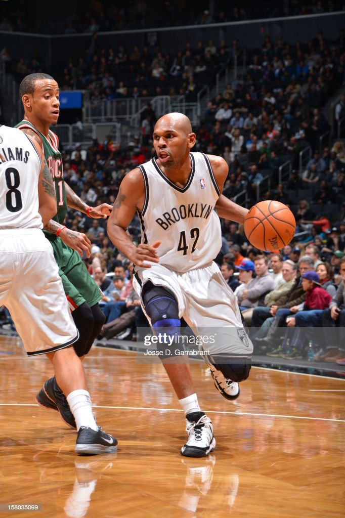 Jerry Stackhouse #42 of the Brooklyn Nets drives against Monta Ellis #11 of the Milwaukee Bucks during the game at the Barclays Center on December 9, 2012 in Brooklyn, New York.