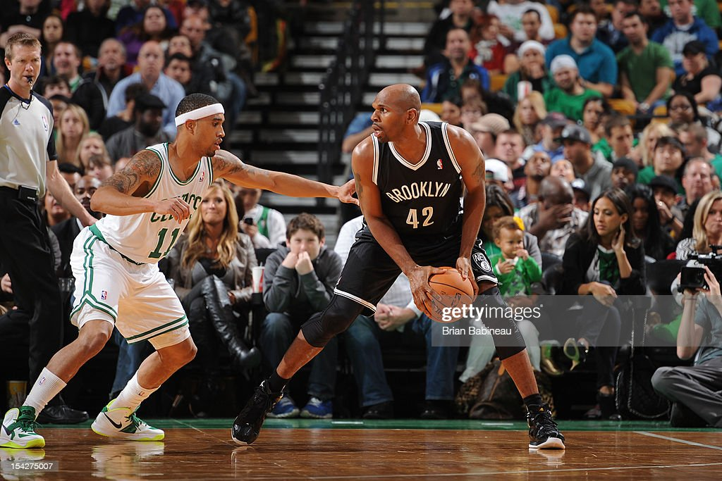 Jerry Stackhouse #42 of the Brooklyn Nets handles the ball against Courtney Lee #11 of the Boston Celtics on October 16, 2012 at the TD Garden in Boston, Massachusetts.