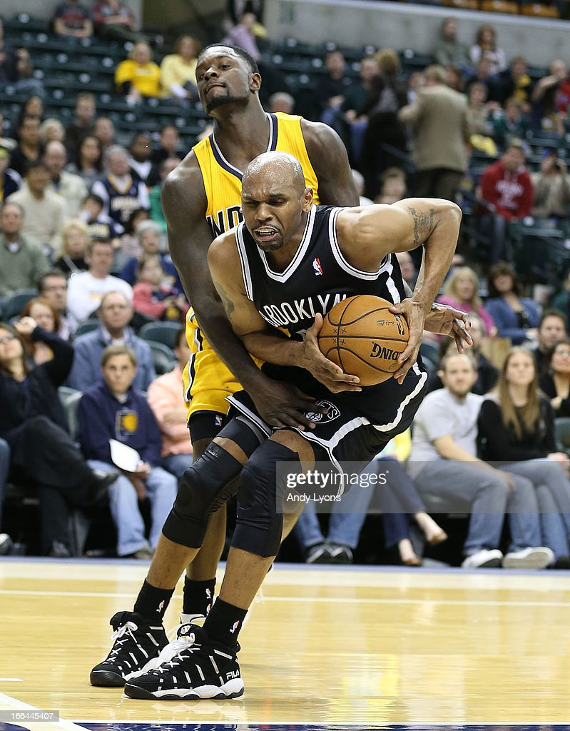 <a gi-track='captionPersonalityLinkClicked' href=/galleries/search?phrase=Jerry+Stackhouse&family=editorial&specificpeople=201683 ng-click='$event.stopPropagation()'>Jerry Stackhouse</a> # 42 of the Brooklyn Nets is fouled by <a gi-track='captionPersonalityLinkClicked' href=/galleries/search?phrase=Lance+Stephenson&family=editorial&specificpeople=5298304 ng-click='$event.stopPropagation()'>Lance Stephenson</a> #1 of the Indiana Pacers at Bankers Life Fieldhouse on April 12, 2013 in Indianapolis, Indiana.