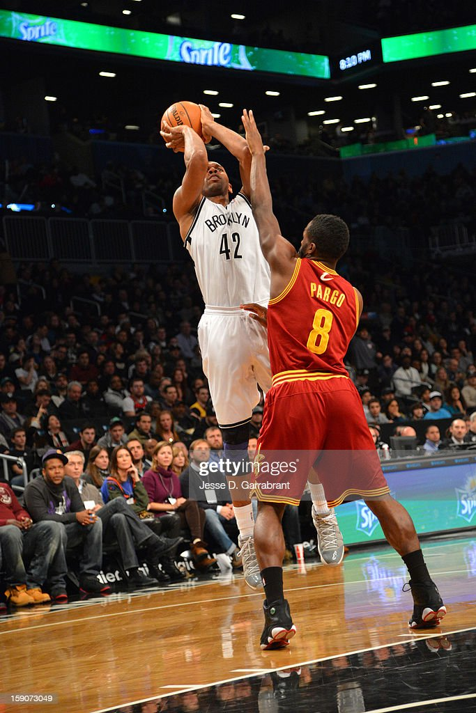 <a gi-track='captionPersonalityLinkClicked' href=/galleries/search?phrase=Jerry+Stackhouse&family=editorial&specificpeople=201683 ng-click='$event.stopPropagation()'>Jerry Stackhouse</a> #42 of the Brooklyn Nets shoots against <a gi-track='captionPersonalityLinkClicked' href=/galleries/search?phrase=Jeremy+Pargo&family=editorial&specificpeople=732443 ng-click='$event.stopPropagation()'>Jeremy Pargo</a> #8 of the Cleveland Cavaliers at the Barclays Center on December 29, 2012 in Brooklyn, New York.