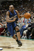 Jerry Stackhouse of the Washington Wizards drives against the Minnesota Timberwolves during the game at Target Center on April 2 2004 in Minneapolis...