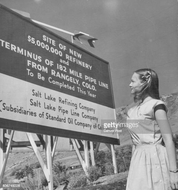 Jerry Stewart of Salt lake city reads a sign announcing the construction of a new multi million dollar refinery which will process crude oil...