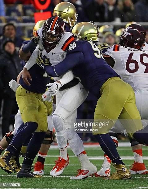 Jerry Tillery of the Notre Dame Fighting Irish is called for roughing the asser against Jerod Evans of the Virginia Tech Hokies at Notre Dame Stadium...