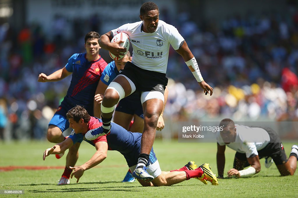 Jerry Tuwai of Fiji jumps to break a tackle on his way to scoring a try during the 2016 Sydney Sevens match between Fiji and France at Allianz Stadium on February 6, 2016 in Sydney, Australia.