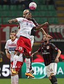 Jerry Uche Mbakogu of Carpi FC competes for the ball with Alex Dias da Costa of AC Milan during the Serie A match between AC Milan and Carpi FC at...