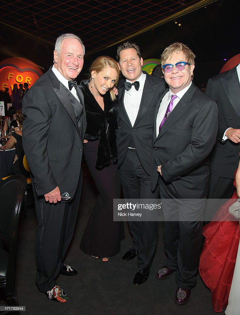 Jerry Weintraub, Uma Thurman, Arpad Busson and Sir Elton John attend the 15th Annual White Tie and Tiara Ball to Benefit Elton John AIDS Foundation in Association with Chopard at Woodside on June 27, 2013 in Windsor, England. No sales to online/digital media worldwide until the 14th of July. No sales before July 14th, 2013 in UK, Spain, Switzerland, Mexico, Dubai, Russia, Serbia, Bulgaria, Turkey, Argentina, Chile, Peru, Ecuador, Colombia, Venezuela, Puerto Rico, Dominican Republic, Greece, Canada, Thailand, Indonesia, Morocco, Malaysia, India, Pakistan, Nigeria. All pictures are for editorial use only and mention of 'Chopard' and 'The Elton John Aids Foundation' are compulsory. No sales ever to Ok, Now, Closer, Reveal, Heat, Look or Grazia magazines in the United Kingdom. No sales ever to any jewellers or watchmakers other than Chopard.