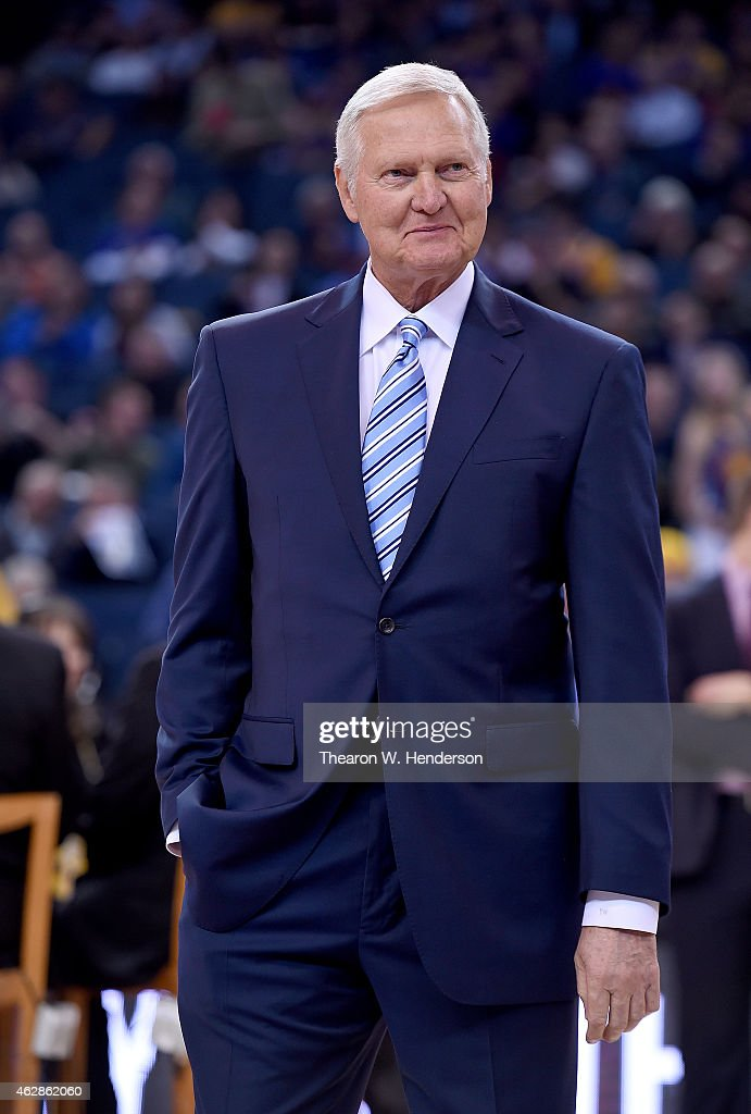 Jerry West former NBA star and executive board member of the Golden State Warriors stands on the court prior to an the game against the Dallas...