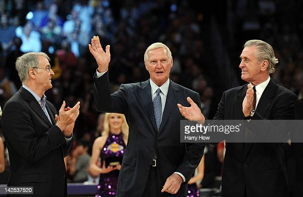 Jerry West is announced to the crowd in front of Gail Goodrich and Pat Riley as the 1972 NBA Championshipi team is honored at halftime during the...