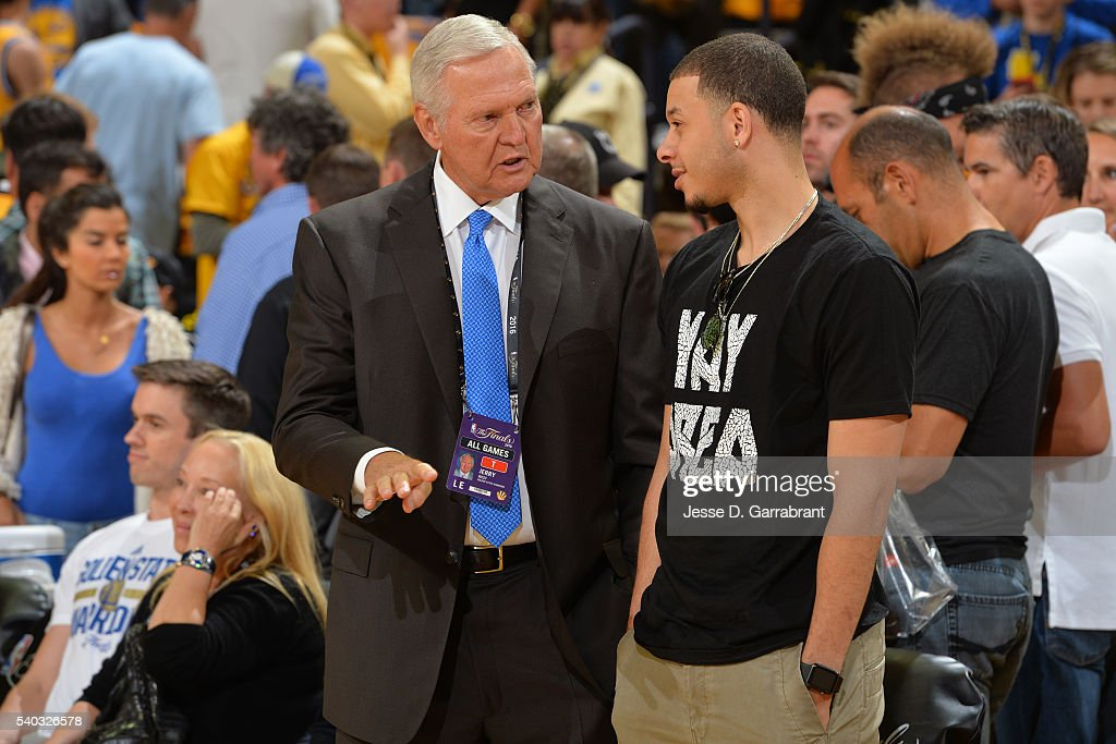 Jerry West of the Golden State Warriors talks to Seth Curry of the Sacramento Kings before Game Five of the 2016 NBA Finals between the Cleveland...