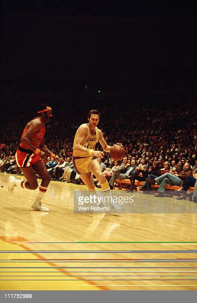 Jerry West of the Los Angeles Lakers dribbles against the Washington Bullets at the Great Western Forum in Inglewood California circa 1971 NOTE TO...