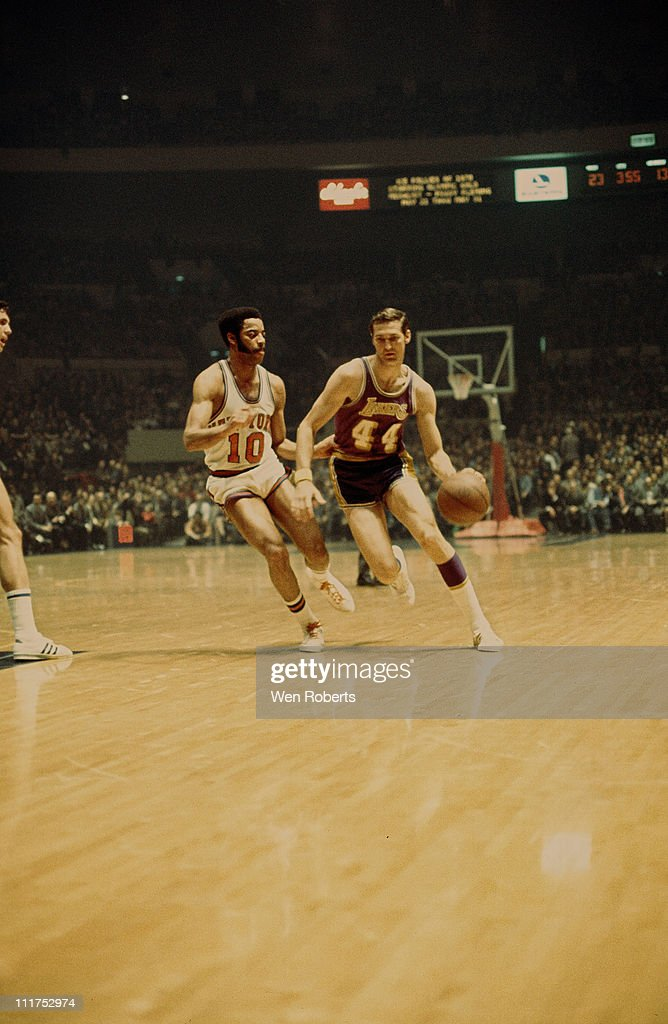 Jerry West of the Los Angeles Lakers dribbles against Walt Frazier of the New York Knicks at Madison Square Garden in New York City circa 1971 NOTE...