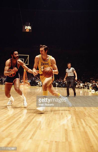 Jerry West of the Los Angeles Lakers dribbles against Walt Frazier of the New York Knicks at the Great Western Forum in Inglewood California circa...
