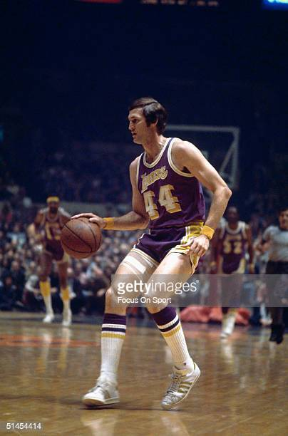 Jerry West of the Los Angeles Lakers dribbles down the court during the game against the New York Knicks circa 1960's at Madison Square Garden in New...