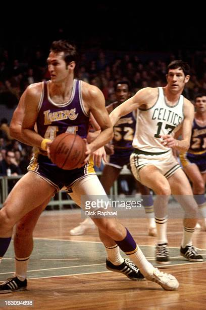 Jerry West of the Los Angeles Lakers dribbles the ball against the Boston Celtics circa 1970 at the Boston Garden in Boston Massachusetts NOTE TO...
