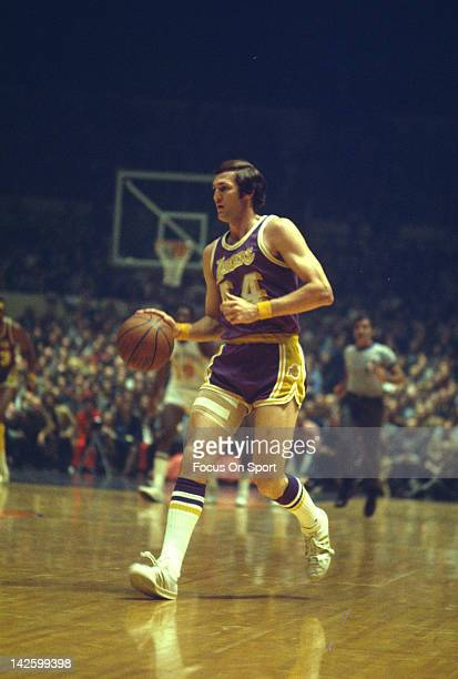 Jerry West of the Los Angeles Lakers dribbles the ball up court against the New York Knicks during an NBA basketball game circa 1972 at Madison...