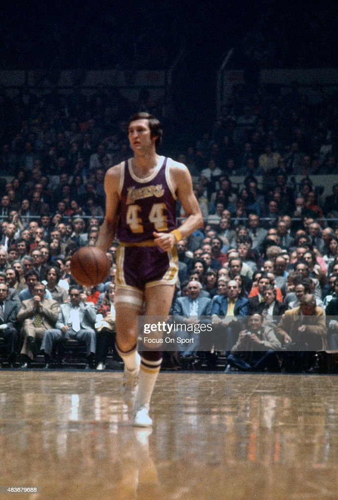 Jerry West of the Los Angeles Lakers dribbles the ball up court against the New York Knicks during an NBA basketball game circa 1969 at Madison...