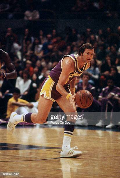 Jerry West of the Los Angeles Lakers dribbles the ball up court against the Golden State Warriors during an NBA basketball game circa 1973 at the...
