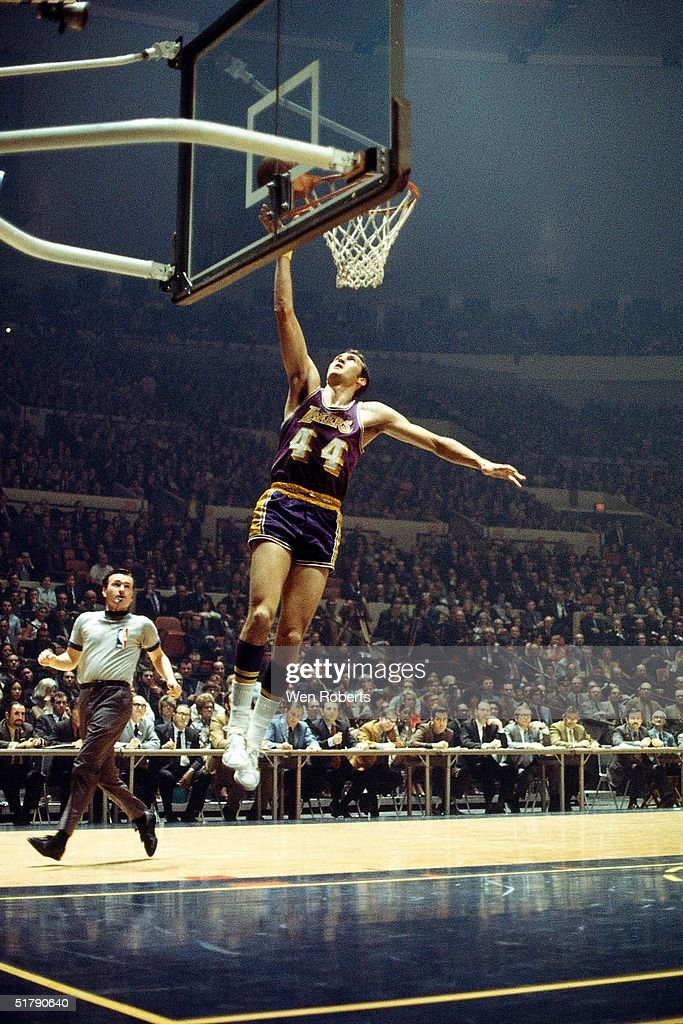 Jerry West of the Los Angeles Lakers goes for a layup against the New York Knicks during the NBA game at Madison Square Garden in New York New York...