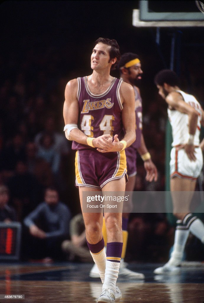 Jerry West of the Los Angeles Lakers looks on walking up court against the Milwaukee Bucks during an NBA basketball game circa 1972 at the Milwaukee...