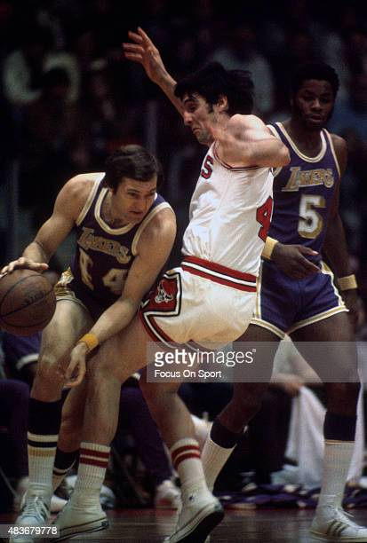 Jerry West of the Los Angeles Lakers looks to dribble past Jerry Sloan of the Chicago Bulls during an NBA basketball game circa 1970 at the Chicago...