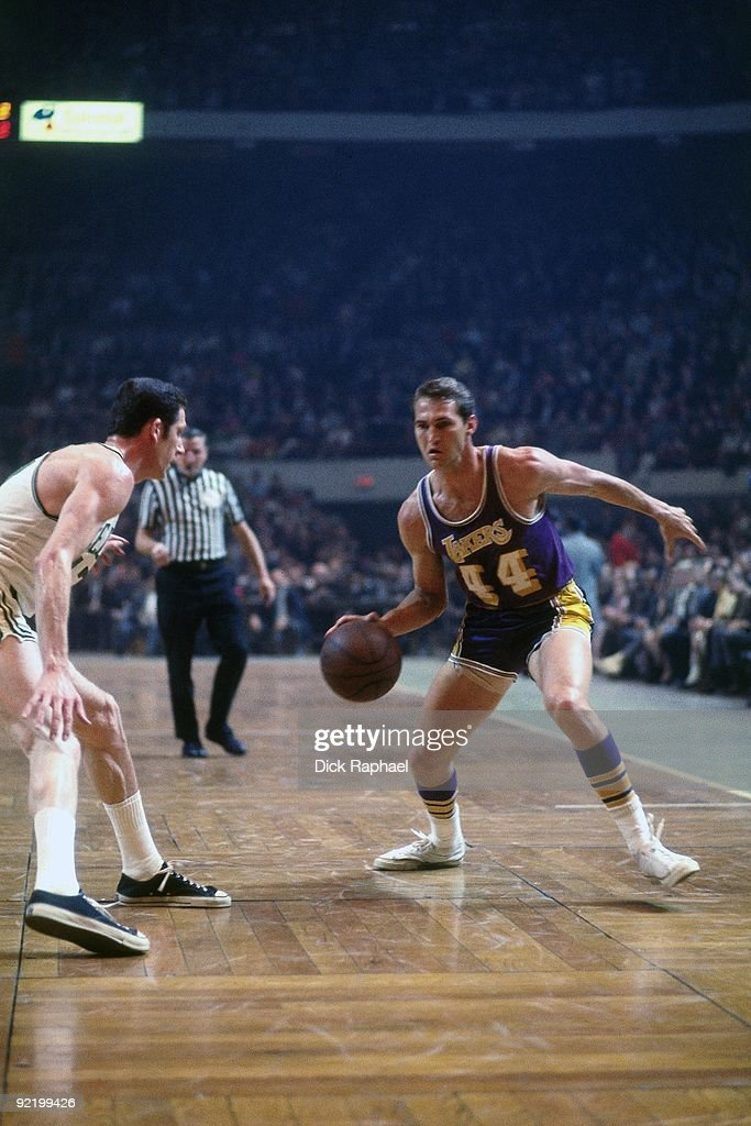 Jerry West of the Los Angeles Lakers makes a move to the basket against the Boston Celtics during a game played in 1968 at the Boston Garden in...