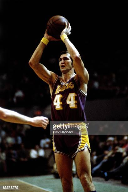 Jerry West of the Los Angeles Lakers passes against the Boston Celtics during a game played circa 1972 at the Boston Garden in Boston Massachusetts...