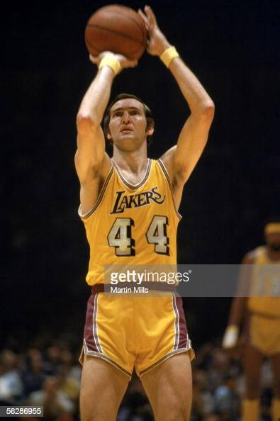 Jerry West of the Los Angeles Lakers shoots a free throw during a 1971 NBA game against the New York Knicks at the Great Western Forum in Inglewood...