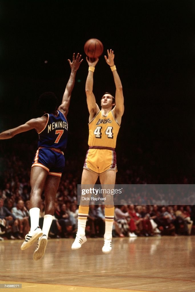 Jerry West of the Los Angeles Lakers shoots a jump shot against Dean Memninger of the New York Knicks during a 1975 NBA game at the Forum in Los...