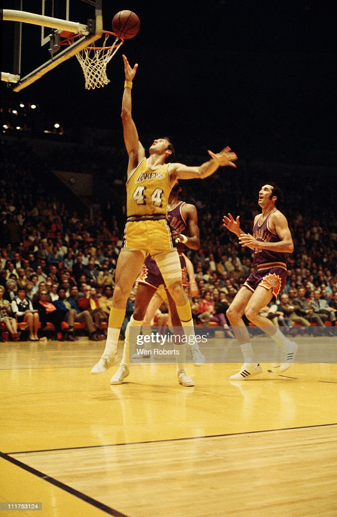 Jerry West of the Los Angeles Lakers shoots against the Phoenix Suns at the Great Western Forum in Inglewood California circa 1971 NOTE TO USER User...