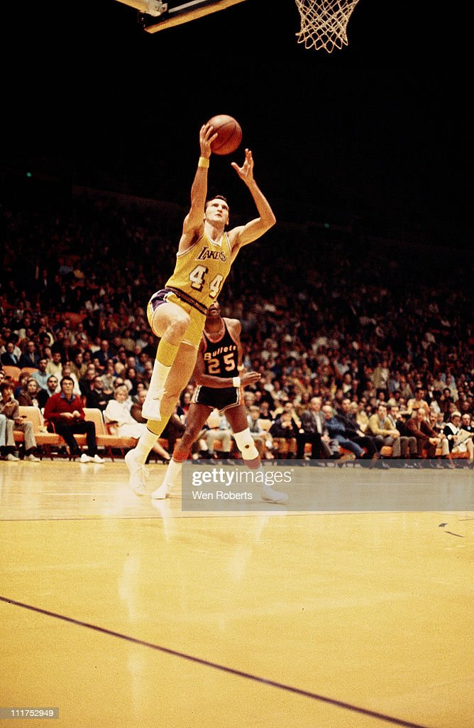 Jerry West of the Los Angeles Lakers shoots against the Washington Bullets at the Great Western Forum in Inglewood California circa 1971 NOTE TO USER...