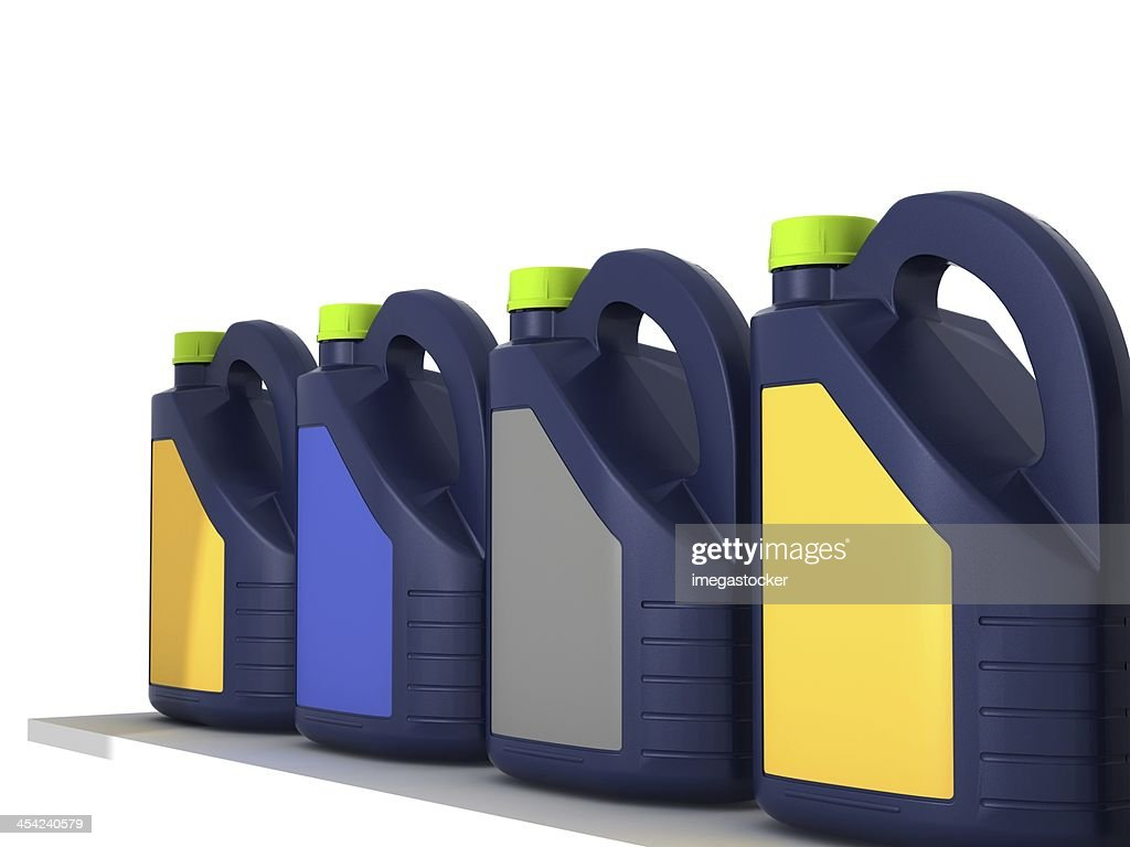 Jerrycans with car engine oil - isolated : Stock Photo