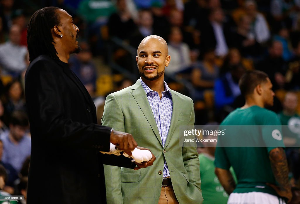 Jerryd Bayless #11 and Gerald Wallace #45 of the Boston Celtics talk near the bench during a timeout against the Washington Wizards in the second half during the game at TD Garden on April 16, 2014 in Boston, Massachusetts.