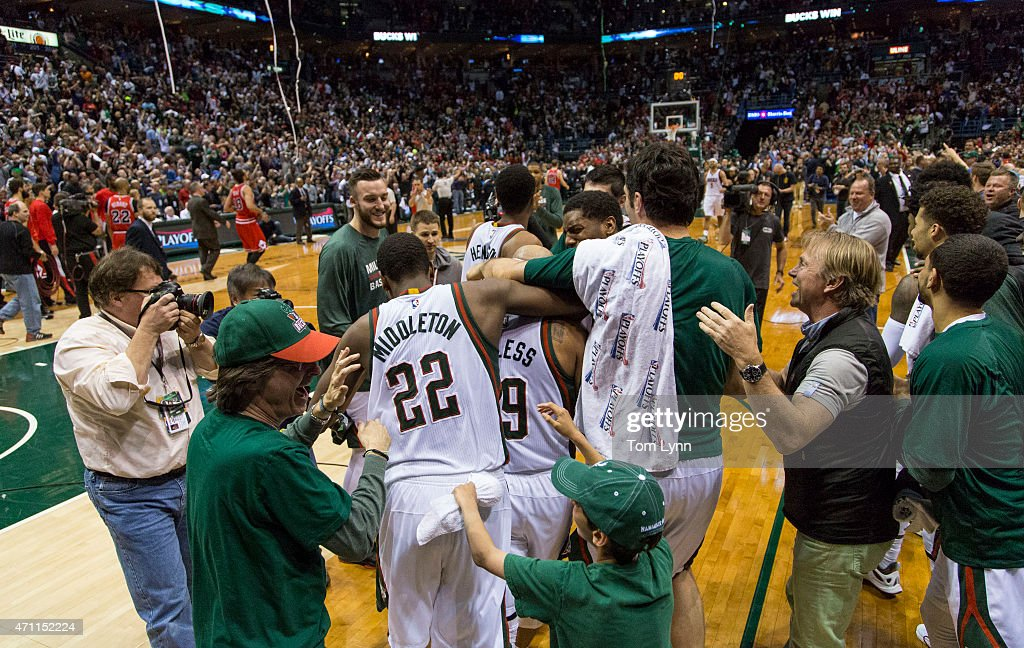 Jerryd Bayless center with head band of the Milwaukee Bucks is swarmed by teammates Khris Middleton left and Zaza Pachulia right after he hit the...