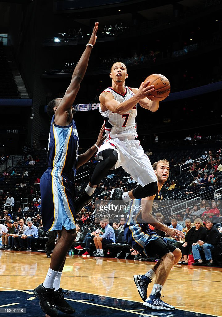 <a gi-track='captionPersonalityLinkClicked' href=/galleries/search?phrase=Jerryd+Bayless&family=editorial&specificpeople=4216027 ng-click='$event.stopPropagation()'>Jerryd Bayless</a> #7 of the Atlanta Hawks goes up for the layup against the Memphis Grizzlies on October 20, 2013 at Philips Arena in Atlanta, Georgia.