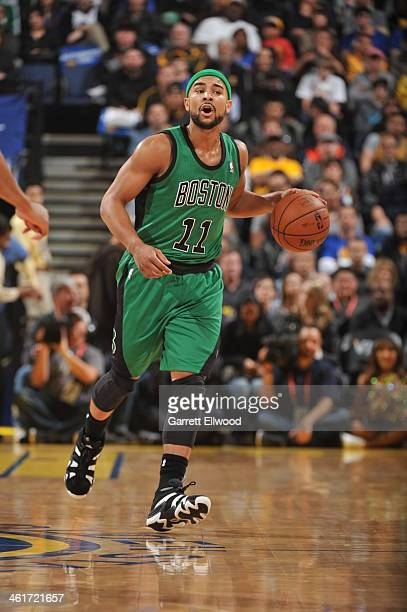 Jerryd Bayless of the Boston Celtics brings the ball up the court against the Golden State Warriors on January 10 2014 at Oracle Arena in Oakland...