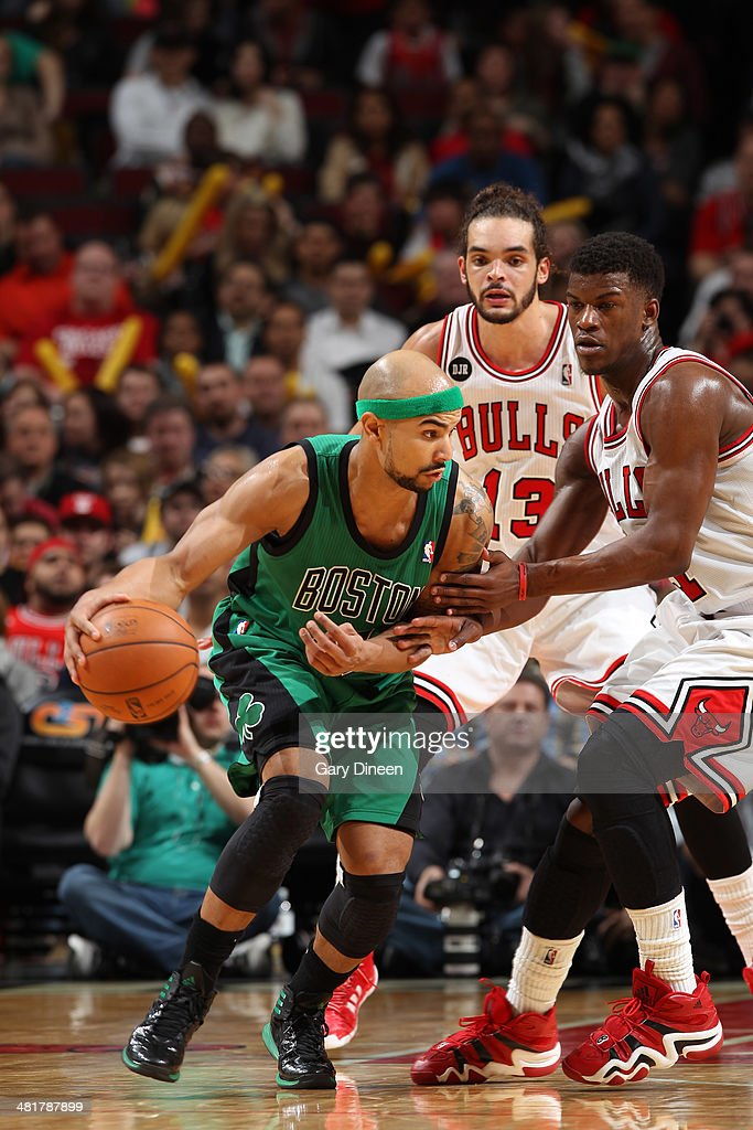 Jerryd Bayless #11 of the Boston Celtics handles the ball against the Chicago Bulls on March 31, 2014 at the United Center in Chicago, Illinois.