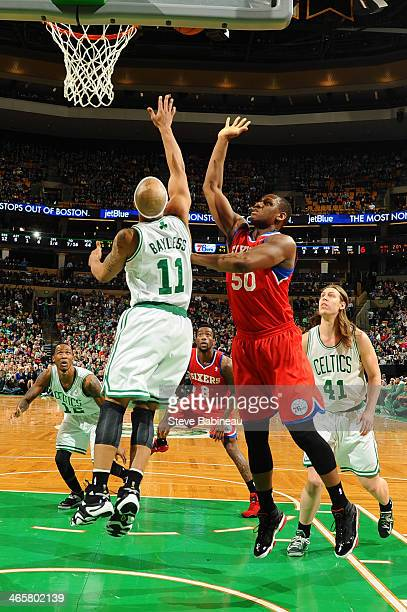 Jerryd Bayless of the Boston Celtics jumps up for the rebound against Lavoy Allen of the Philadelphia 76ers on January 29 2014 at the TD Garden in...